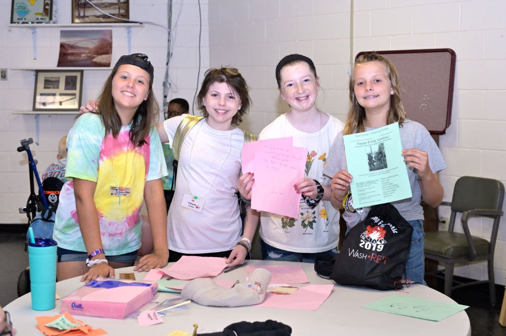 Kids doing arts and crafts at Camp Fantastic